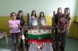 """Ученици от СУ """"Георги Измирлиев"""" изтъкаха националното знаме"""